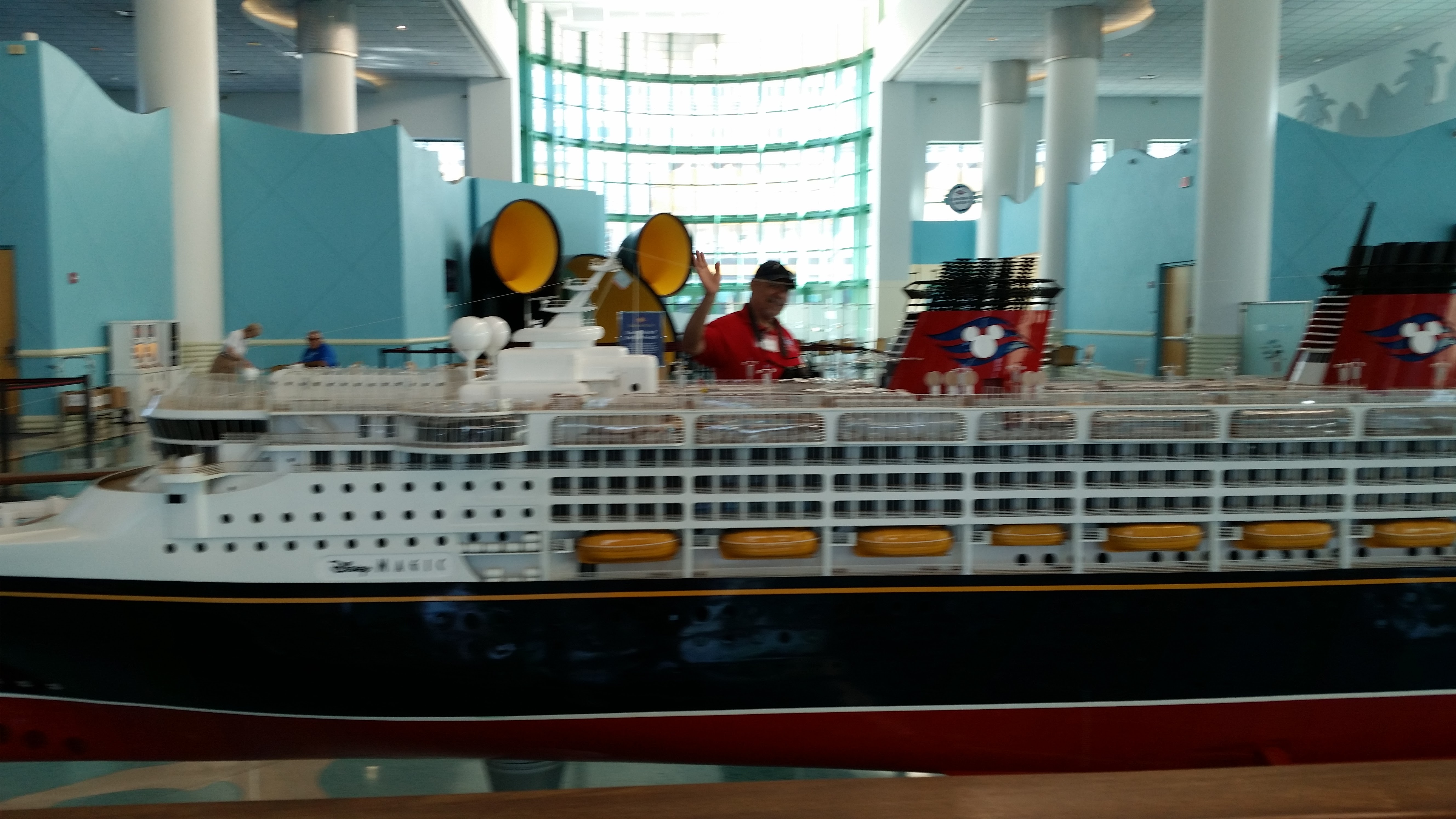 Nelson Echevarria at Disney Cruise Line Terminal in Port Canaveral in front of replica of the Disney Dream