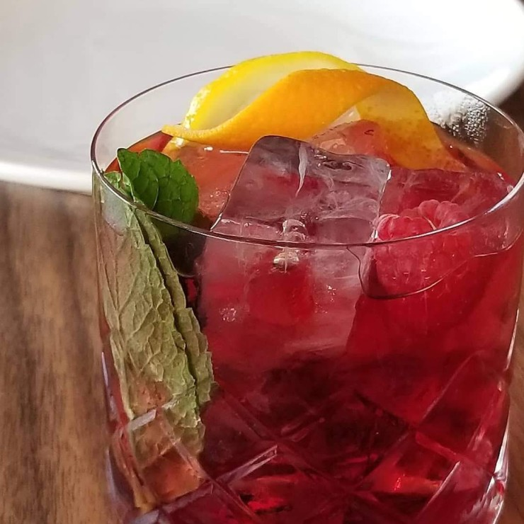 Sangria - Spanish Sweet red wine with raspberry, orange peel, lemon slice and mint